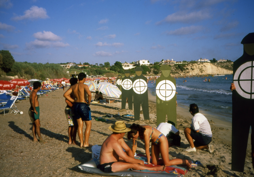 Soldier Targets in a beach among swimmers