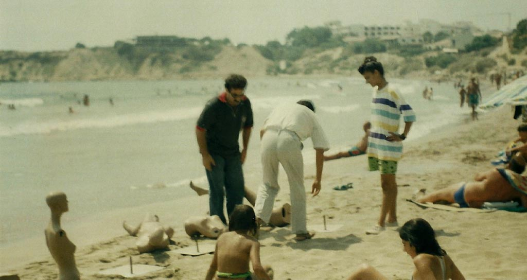 The artist installing Mannequins at the beach