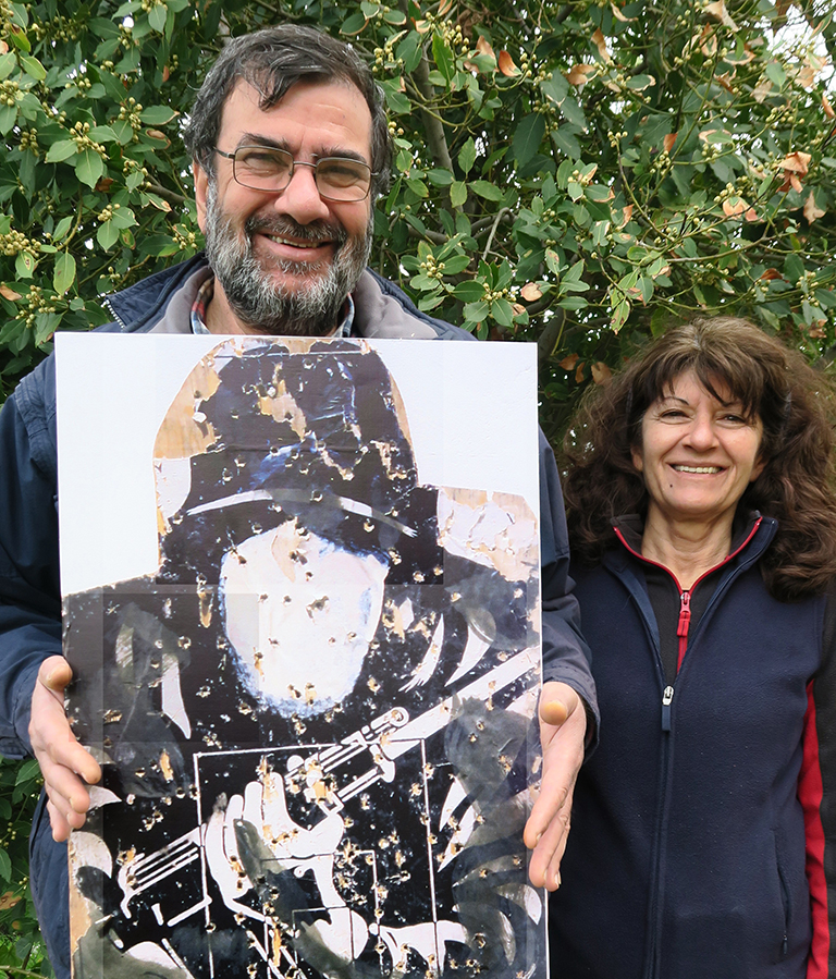 A couple holding a target